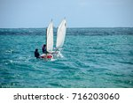 placencia  belize   february 15 ... | Shutterstock . vector #716203060