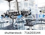 bottling plant   water bottling ... | Shutterstock . vector #716203144