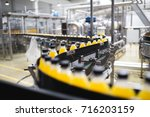 industrial factory indoors and... | Shutterstock . vector #716203159