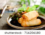 fried chinese spring rolls with ... | Shutterstock . vector #716206180