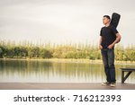 Young Man With  Bag Guitar ...