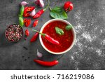 composition with chili sauce in ... | Shutterstock . vector #716219086