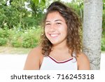 candid woman with perfect teeth ... | Shutterstock . vector #716245318