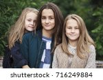 close up portrait of three... | Shutterstock . vector #716249884