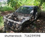 Old Rusted Car Wreck In Junk...