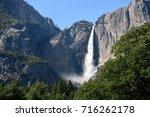 waterfall in in yosemite... | Shutterstock . vector #716262178