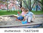 two cute little children... | Shutterstock . vector #716272648