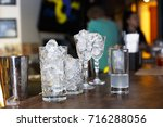 ice in cocktail glasses on the... | Shutterstock . vector #716288056