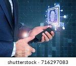business man fingerprint scan... | Shutterstock . vector #716297083