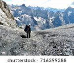 Small photo of Hiker on an abrupt black schist path.
