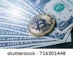 golden bitcoin coins on a paper ... | Shutterstock . vector #716301448