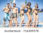 young cheerful people having... | Shutterstock . vector #716309578