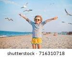 Boy And Seagull On The Beach ...