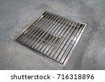 stainless grating cover on... | Shutterstock . vector #716318896