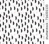 pattern of painted black brush... | Shutterstock .eps vector #716331133