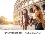young couple at the colosseum ... | Shutterstock . vector #716336140
