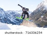 snowboarder performing tricks... | Shutterstock . vector #716336254
