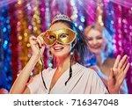 woman in carnival mask | Shutterstock . vector #716347048