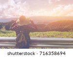 woman traveler with backpack... | Shutterstock . vector #716358694