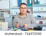 repair on electronic printed... | Shutterstock . vector #716372530