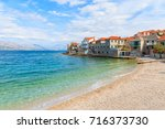 beach in postira town with old... | Shutterstock . vector #716373730