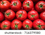 red organic tomatoes with water ... | Shutterstock . vector #716379580