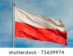 Stock photo polish flag on a pole over beautiful sky 71639974