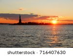 statue of liberty at sunset in... | Shutterstock . vector #716407630