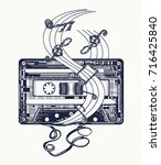 audio cassette and music notes... | Shutterstock .eps vector #716425840