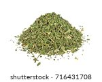 dried parsley isolated on a... | Shutterstock . vector #716431708