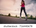 asian woman runner is running. | Shutterstock . vector #716440678