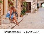 beautiful pretty woman walking... | Shutterstock . vector #716450614