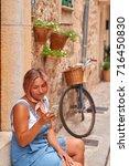 beautiful woman walking on old... | Shutterstock . vector #716450830