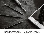 smartphone with a broken screen ... | Shutterstock . vector #716456968