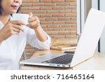 businesswoman in white casual... | Shutterstock . vector #716465164