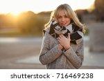 attractive blonde woman in...   Shutterstock . vector #716469238