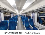 empty train interior with blue... | Shutterstock . vector #716484133