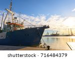 fishing boat at the dock | Shutterstock . vector #716484379