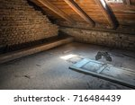 creepy attic interior at... | Shutterstock . vector #716484439