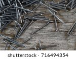 heap of big iron nails on a... | Shutterstock . vector #716494354