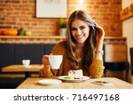 portrait of a beautiful smiling ... | Shutterstock . vector #716497168