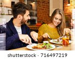 cheerful cute young couple... | Shutterstock . vector #716497219