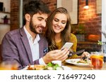 cute young couple looking at...   Shutterstock . vector #716497240