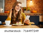 beautiful young woman looking... | Shutterstock . vector #716497249