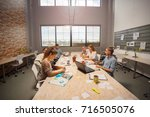 developing new app. team of... | Shutterstock . vector #716505076