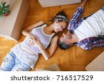 moving in new home. couple... | Shutterstock . vector #716517529