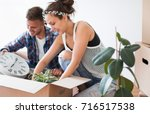 moving day. unpacking things... | Shutterstock . vector #716517538