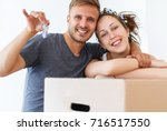 couple showing keys of a new... | Shutterstock . vector #716517550