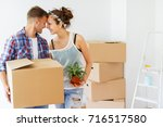 moving day. happy  young couple ... | Shutterstock . vector #716517580