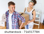 moving into new apartment.... | Shutterstock . vector #716517784
